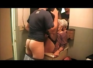 Short haired mature slut sucks and fucks in the toilet
