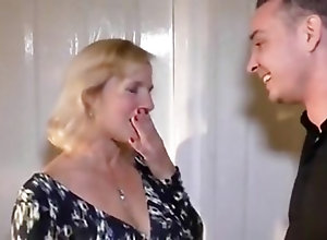Busty mature remembers her youth by fucking a young dude